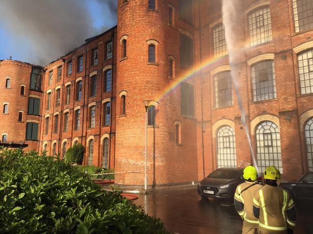 Huge fire rips through block of flats causing severe damage and leaving people homeless
