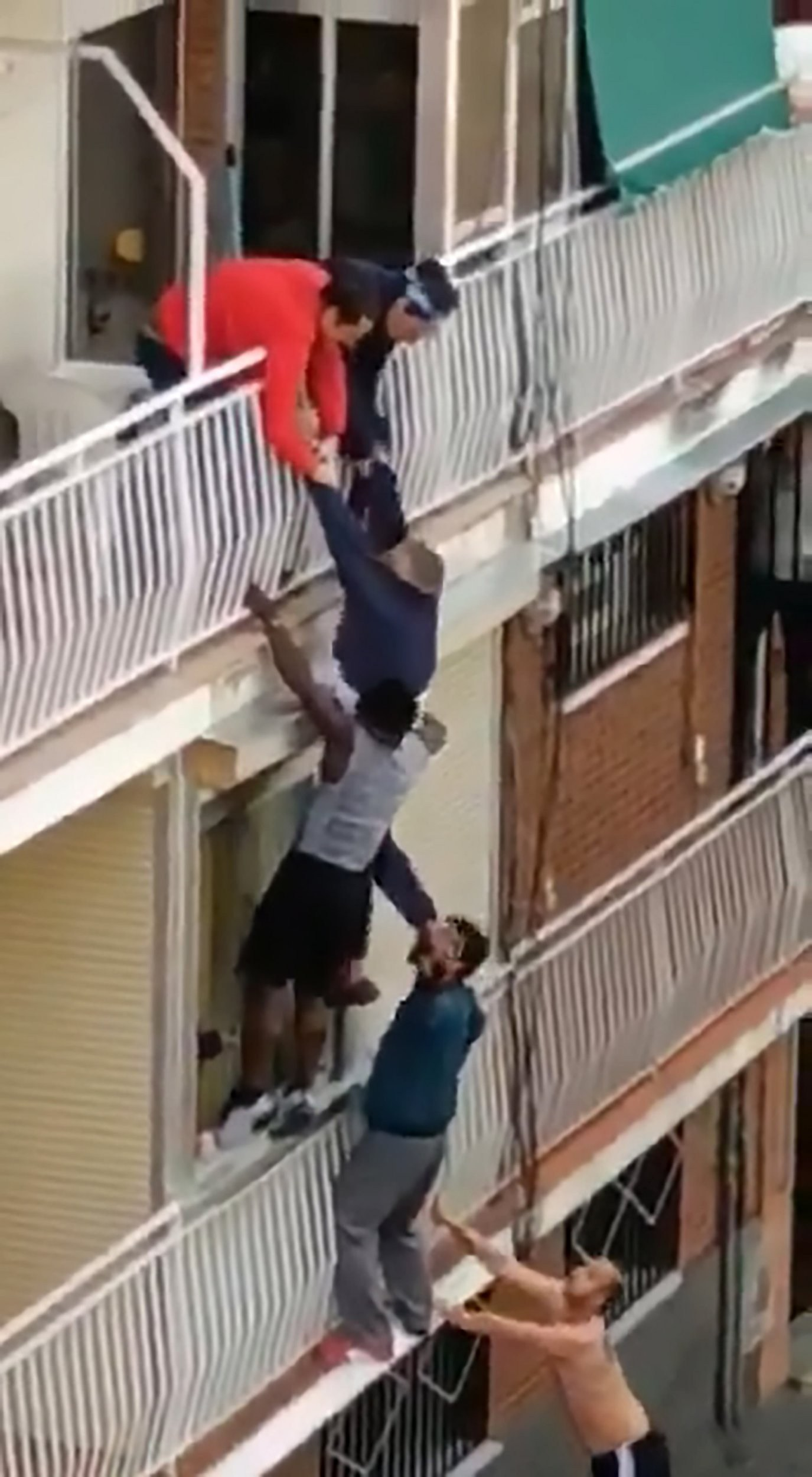 Heroes climb building to save pensioner hanging from balcony