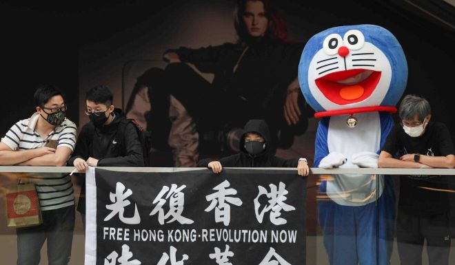 Coronavirus: testing Covid-19 restrictions, protesters gather in the heart of Hong Kong