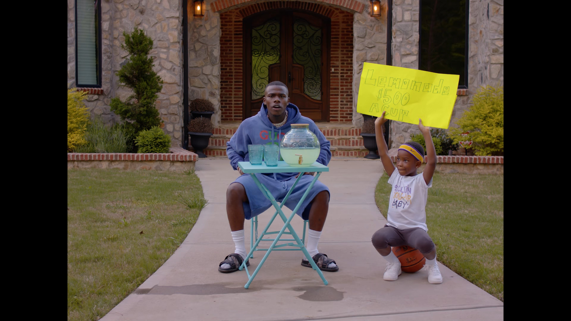 "DaBaby Sells Lemonade in ""Can't Stop"" Video"