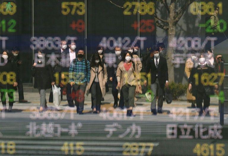 Japan passes $240 billion virus package including cash handouts