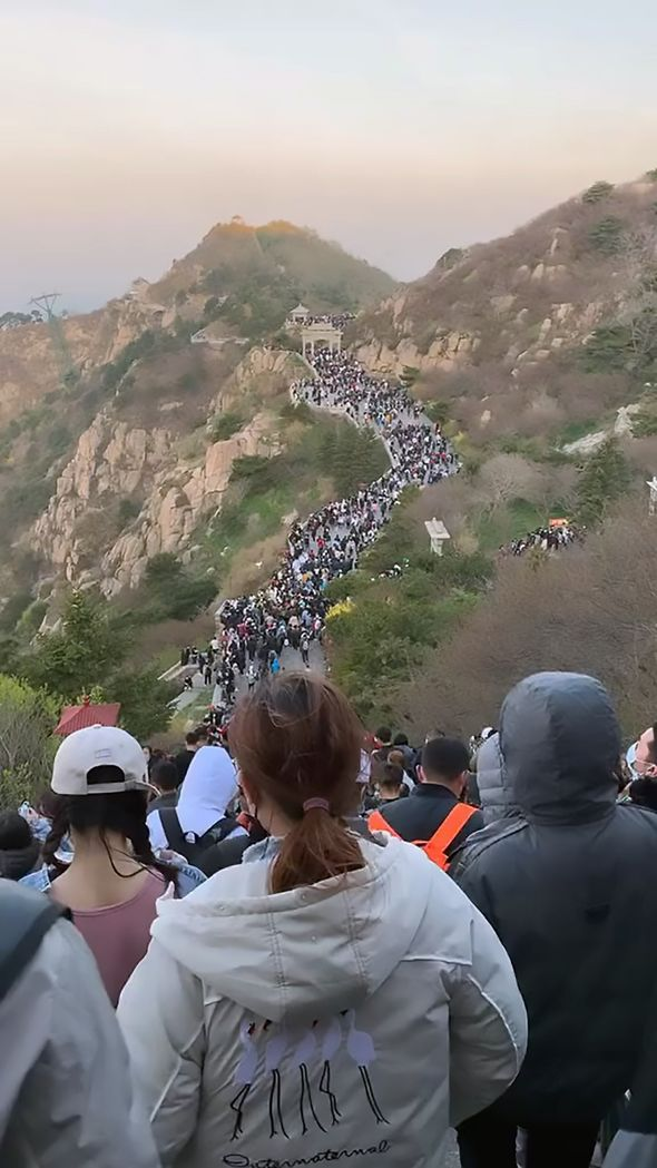Coronavirus social distancing ignored in China as 30,000 flock to watch sunrise - PICTURED