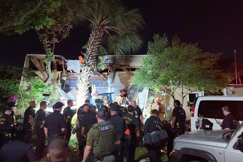 Houston police helicopter crashes into apartment block with officers injured