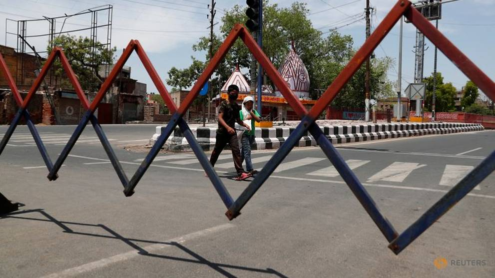 Police clash with migrant workers as India eases coronavirus curbs