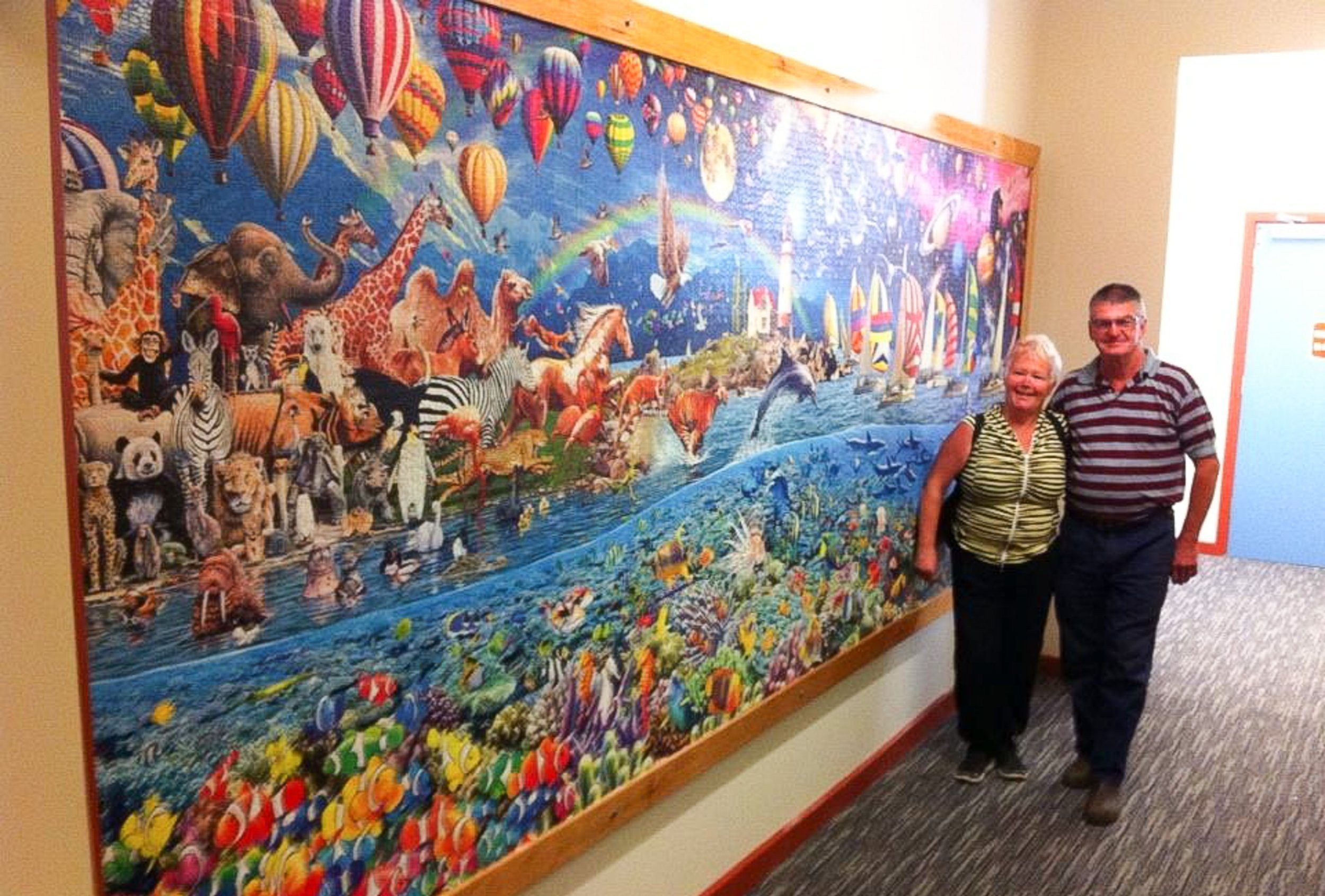 Grandma completes two of the world's largest jigsaw puzzles