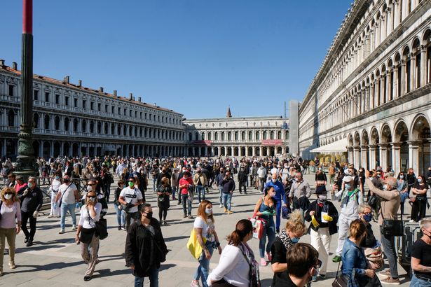 Italians flock to parks as country eases coronavirus lockdown after two months