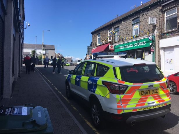 Woman 'knifes man to death in multiple stabbing at village Co-op'