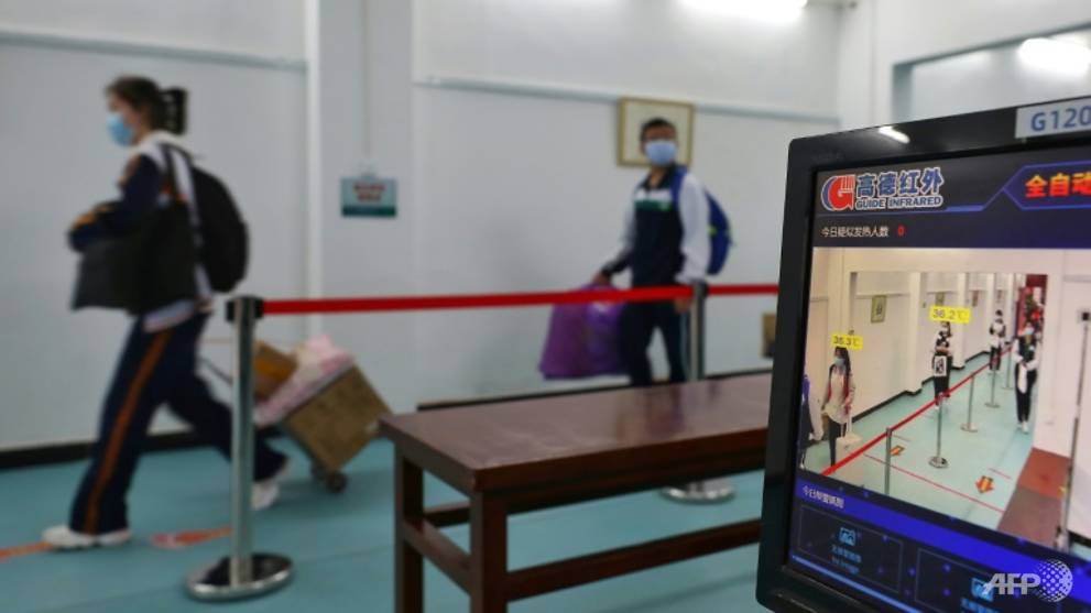 Students in China's virus epicentre Wuhan return to school