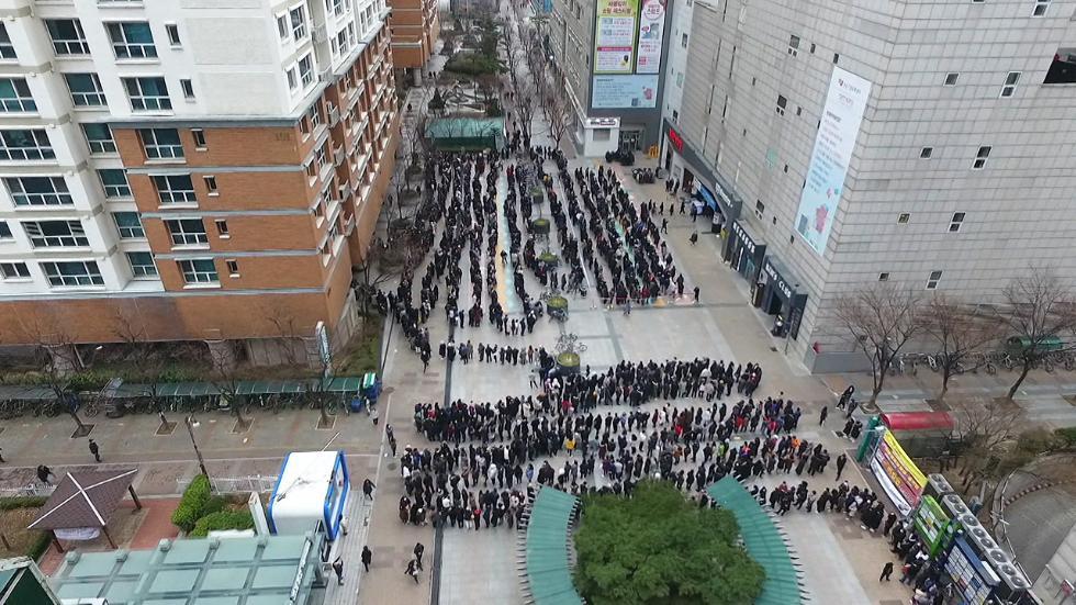 韩国政府计划储备1亿个口罩 防范第二波疫情来袭