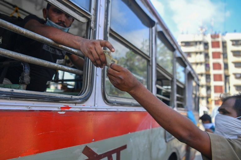 Some Indian trains to roll again despite virus cases surge