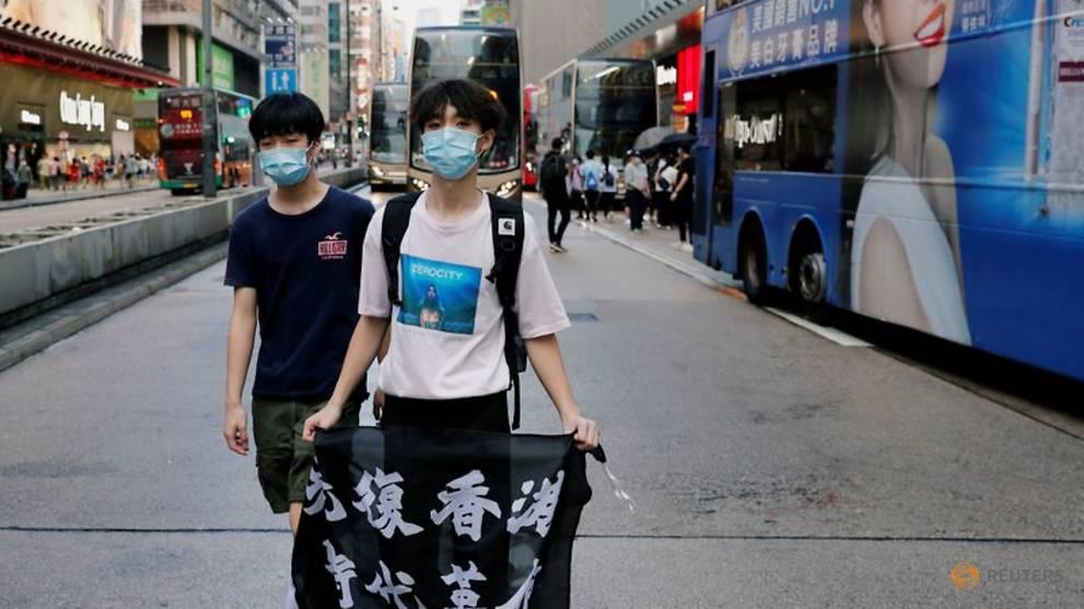 Ignoring social distancing, protesters mock Hong Kong leader Lam on her birthday