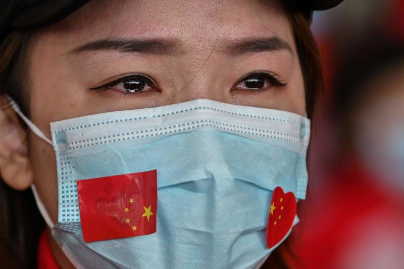 Asia virus latest: China city in lockdown, Seoul sees test surge