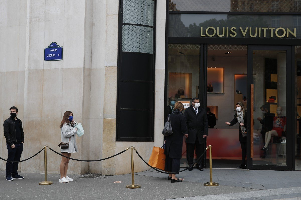 Luxury stores open in Paris that's empty of tourists as France eases coronavirus lockdown restrictions