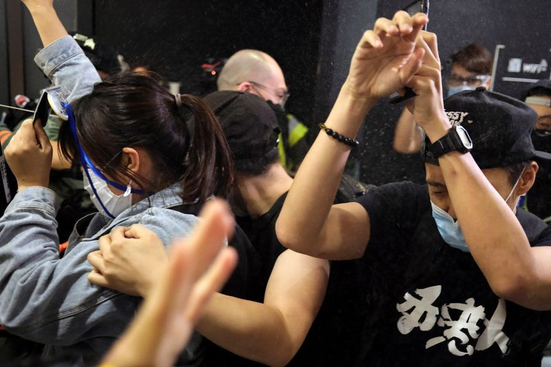 First Hong Kong protester to admit 'rioting' gets four years' jail