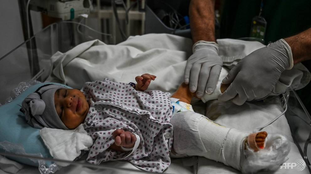 'We cut the cord with our bare hands': Mother gives birth during gun attack at Kabul hospital