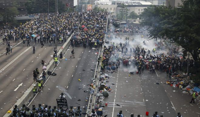 Hong Kong protests: first defendant to plead guilty to riot charge jailed for four years