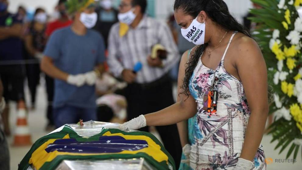 In Amazon city, indigenous chief felled by COVID-19 buried with dance and singing