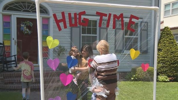 Great-grandma, 85, finally gets to embrace great-grandkids thanks to 'hug machine'