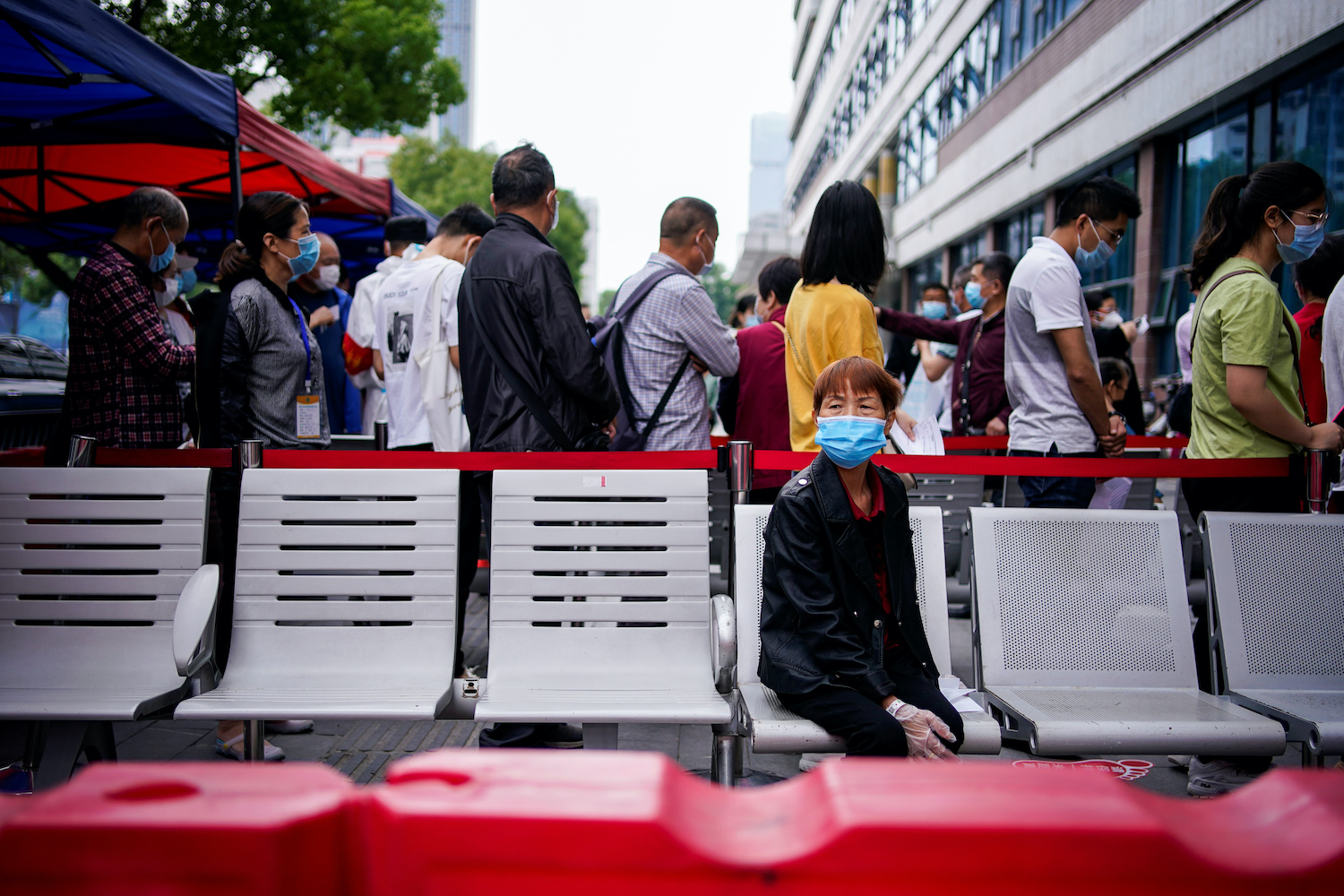 Wary Wuhan residents back new testing blitz