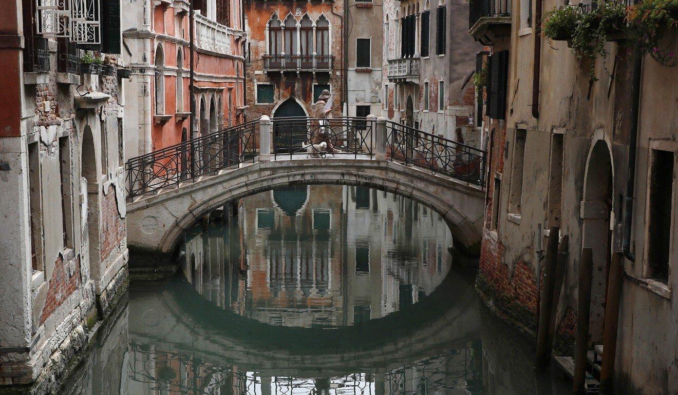 Gondola builder's hands tell story of Venice emptied by coronavirus crisis