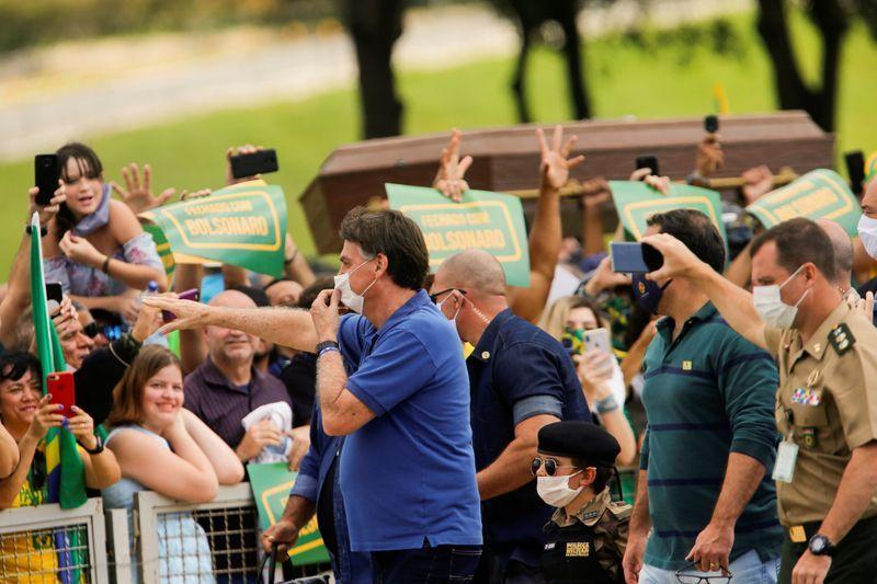 Bolsonaro snaps photos with children at Brazil protest, defying health advice