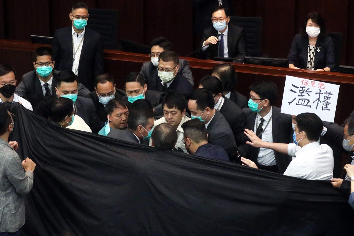 Hong Kong lawmakers thrown out of key Legislative Council meeting after clash with security guards