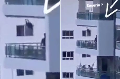 Heart-stopping moment dad spotted pushing toddler on balcony swing 80ft off ground
