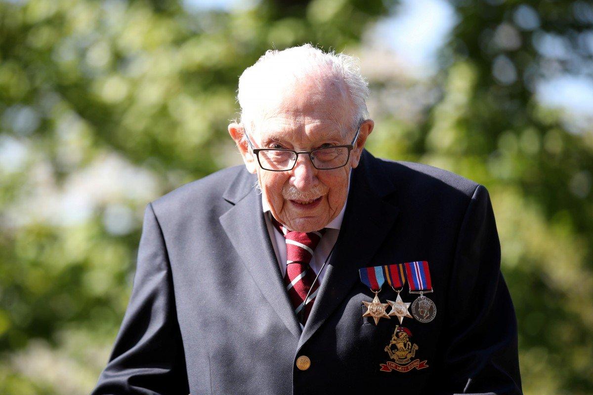 Arise, Sir Tom: UK awards knighthood to war veteran 'Captain Tom' for raising millions for British National Health Service