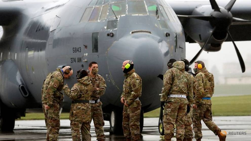 US masses planes at Japan base to show it can handle COVID-19