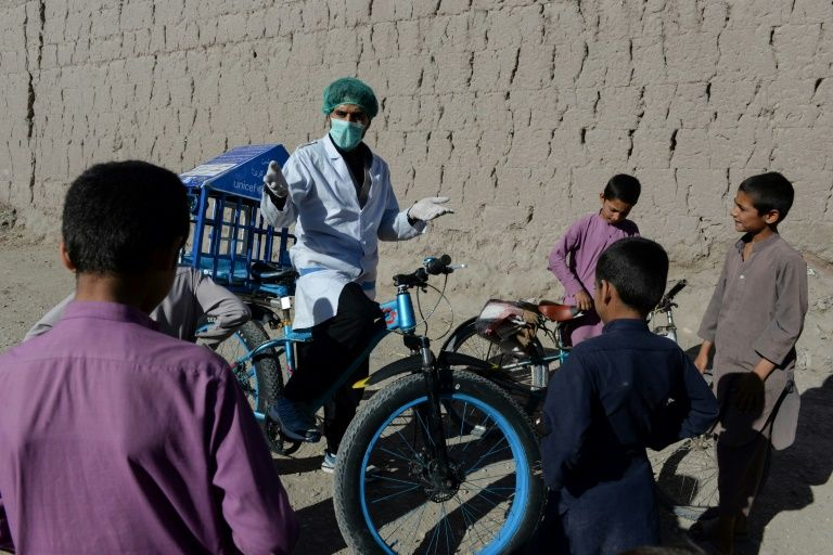 Afghan cyclist in 'door-to-door' campaign to curb virus