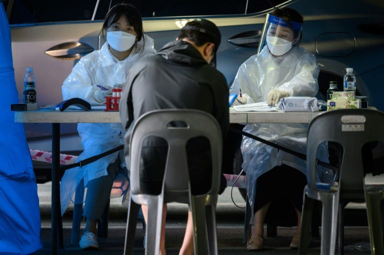 South Korea re-imposes some social restrictions to combat new virus cases