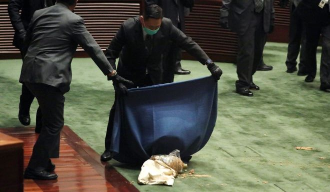 Hong Kong opposition lawmaker delays national anthem debate after throwing rotten plants at Legislative Council president