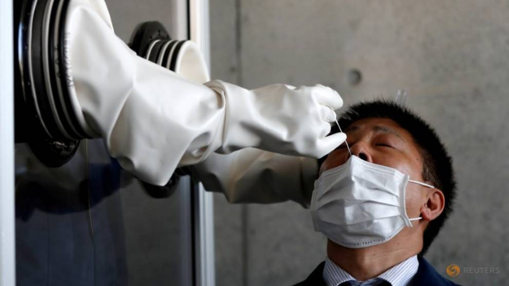 Japan allows saliva-based tests to boost COVID-19 detection