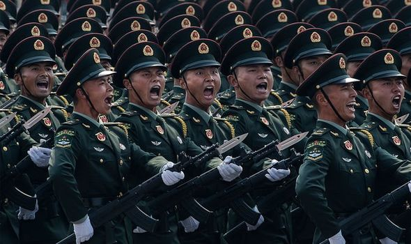 Fears of total war as China repeats threat to INVADE neighbouring Taiwan