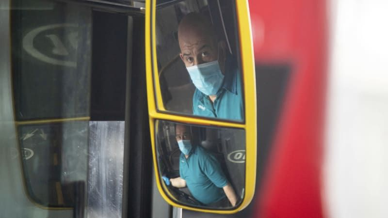 England makes face coverings mandatory on public transport