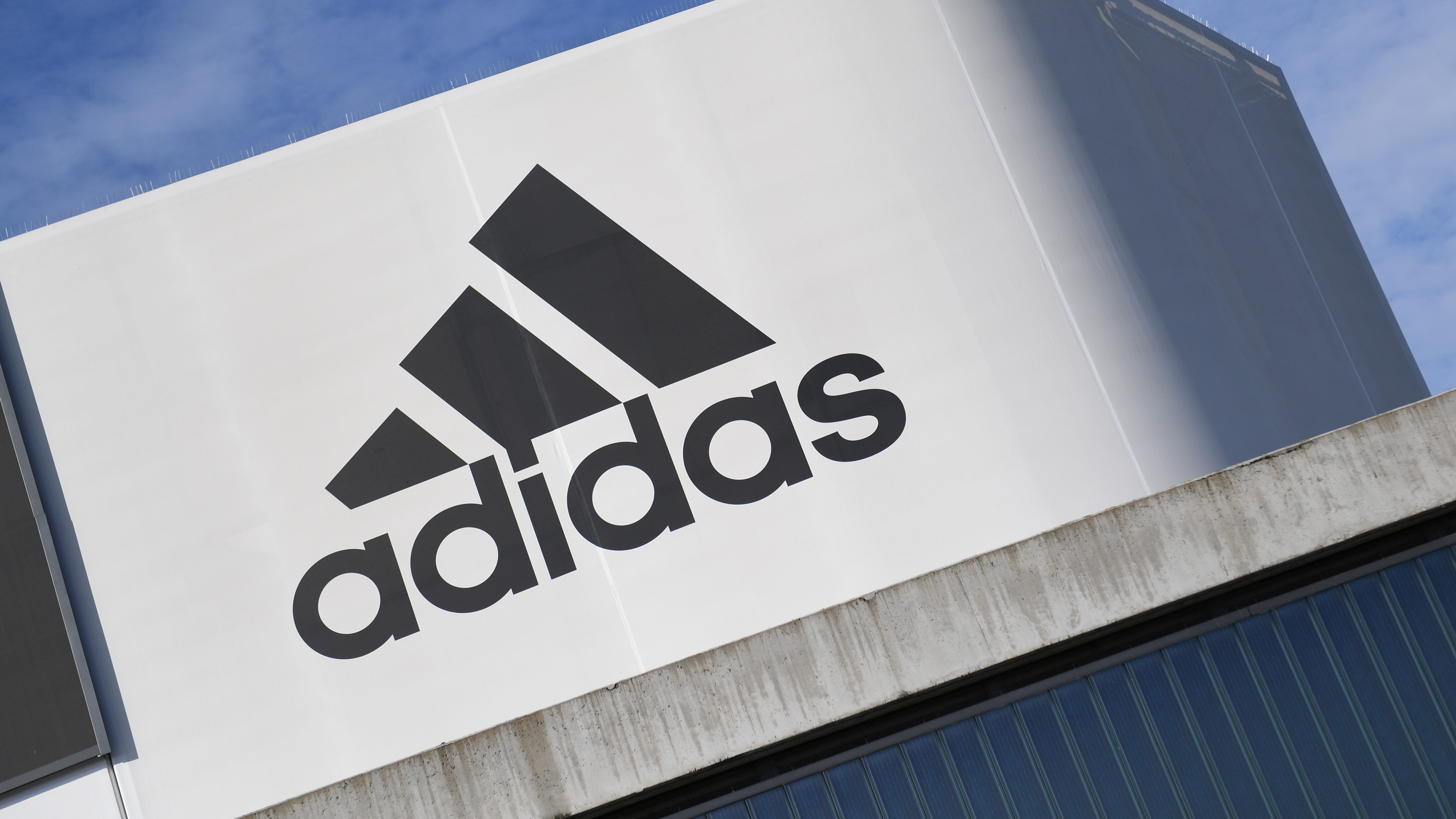 A black Adidas designer is calling on the company to apologize for its complacency on racism