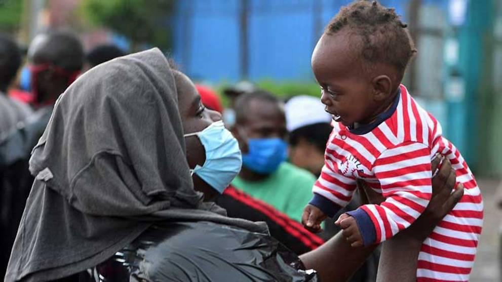 WHO says pandemic 'far from over' as daily cases hit record high