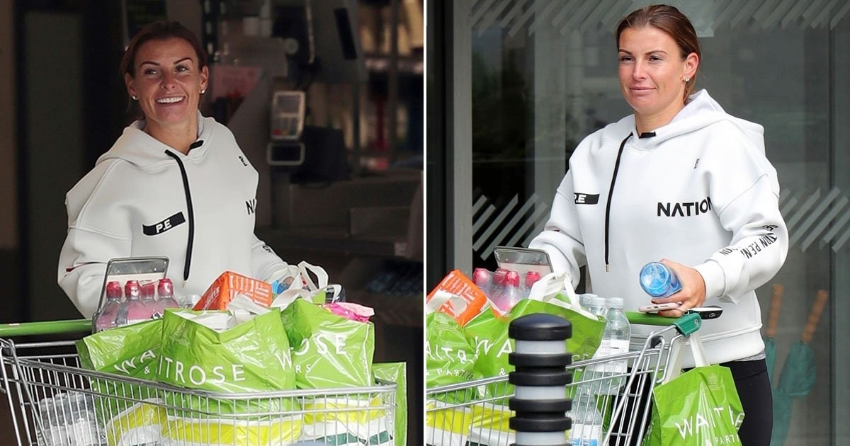 Coleen Rooney all smiles as she steps out to shop after 'sacking legal team over Rebekah Vardy row'