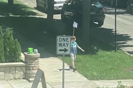 Boy, 9, stages solo Black Lives Matter march outside his home with hand-made sign