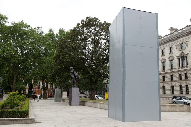 Churchill statue and war memorial boarded up before London protests