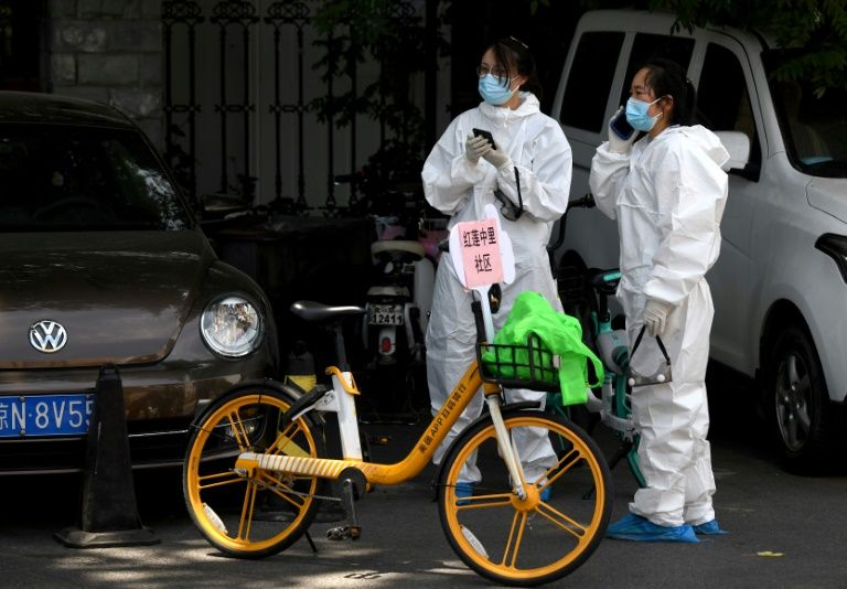Beijing locks areas down as new virus outbreak gathers pace