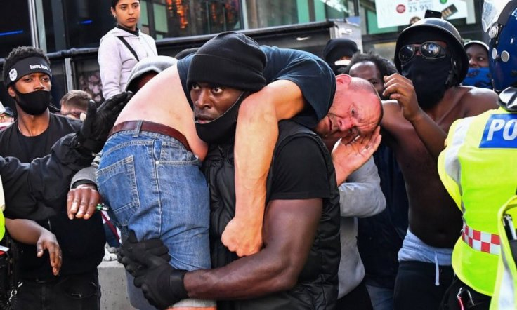 Patrick Hutchinson: Black Man Carries 'Rival' White Protester to Safety Amid Violence