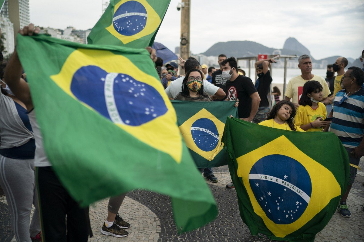 Brazil government stops publishing virus death toll as data befuddles experts