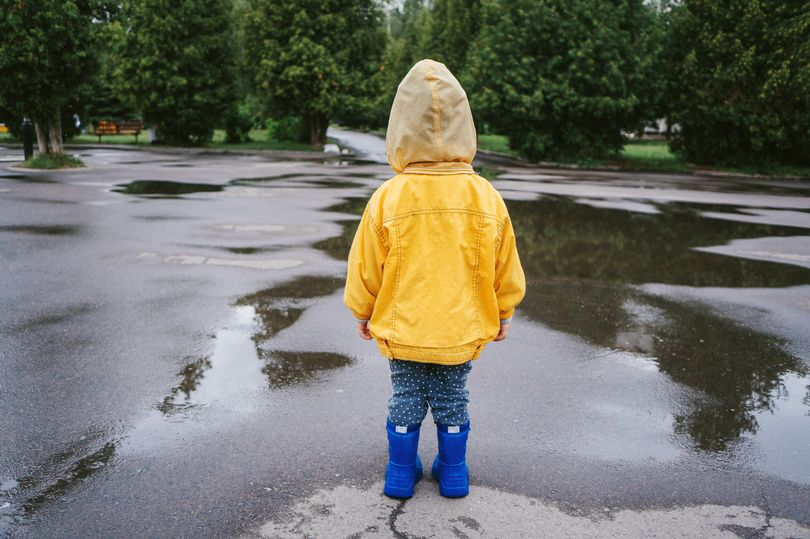 Boy, three, is found wandering the streets wearing onesie and no shoes