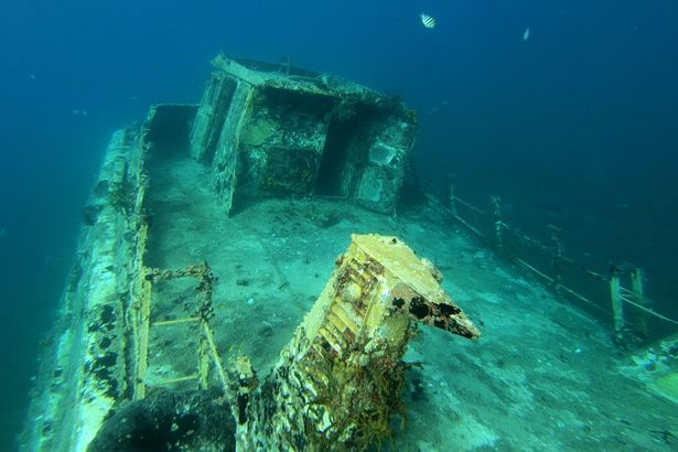 Amazing footage shot by exploring divers shows the spooky insides of sunken ship