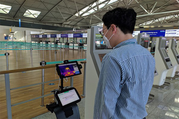 Robots check travellers' body temperatures at Incheon airport