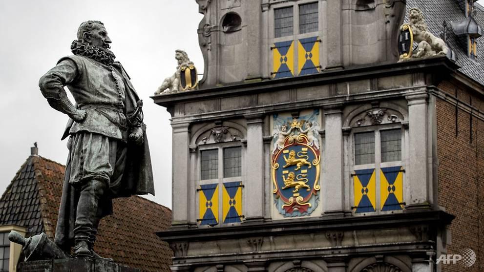Dutch police break up rowdy rallies at colonial-era statue