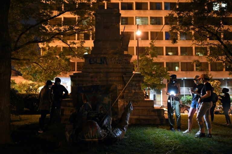 Protesters topple Washington dc statue of confederate general: media