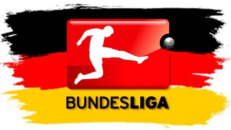 Wolfsburg down Leipzig to regain top spot in Bundesliga