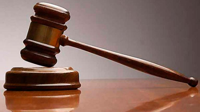 PWD technician claims trial to 4 bribery charges